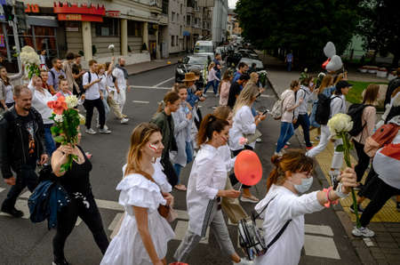 Minsk, Belarus - August 13, 2020: Belarusian people in white clothes with flowers participate in peaceful protest after presidential elections in Belarus.