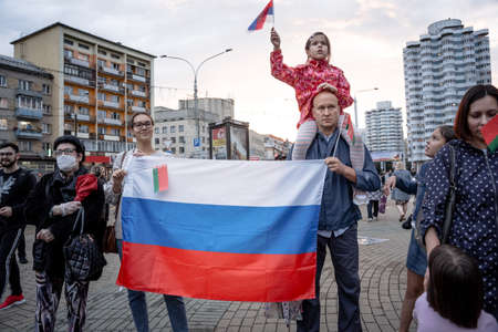 Minsk, Belarus - August 25, 2020: Belarusian people carry flag of Russia in Belarus. Rally in support of the current government Lukashenka