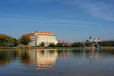 Jesuit collegium building and bridge in Pinsk with reflecrtion in Pina river, Belarus