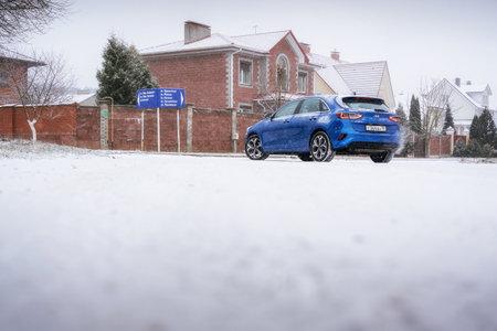 Minsk, Belarus - November 26, 2019: Kia Ceed 2018 car on snowy road against country house