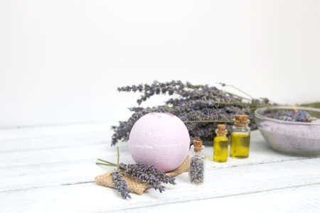 Natural cosmetics. Handmade lavender bath bombs and lavender flowers on white wooden planks