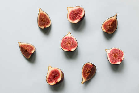 Fresh fig. Fruit with half and quarter on light background. Collection.