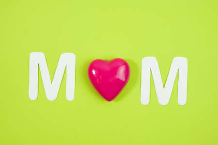 MOM Text with hearts on coloful backround.