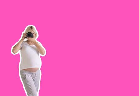 pregnant woman photographer with a film camera 版權商用圖片