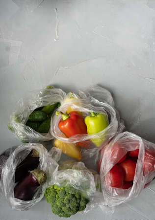 single use plastic packaging issue. vegetables in plastic bags. zero waste concept