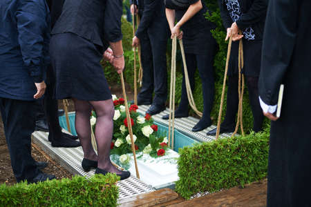 Lowering coffin covered with flowers