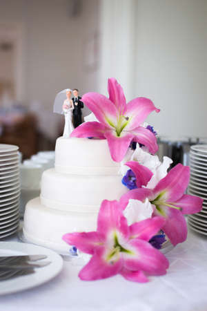 Wedding cake with pink flowers Stock Photo