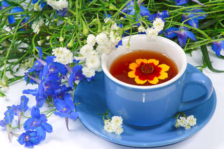 The blue cup of tea with nice flowers