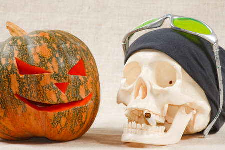 The big cheerful halloween pumpkin and skull with sigarette from canvas background Stock Photo - 9906747