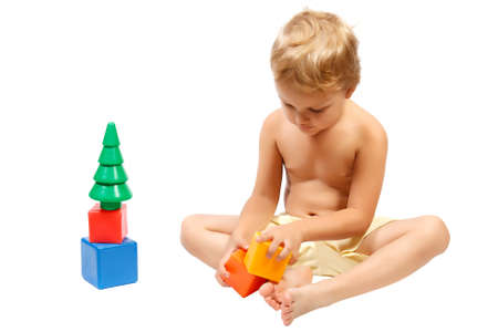 cuddly baby: Little cute boy playing with colorful toys
