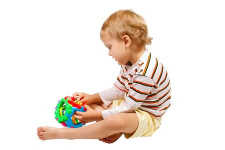 Little cute boy playing with colorful toy Stock Photo - 10578256
