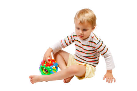 Little cute boy playing with colorful toy Stock Photo - 10529920
