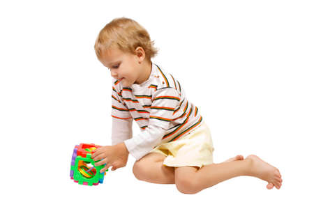 Little cute boy playing with colorful toy Stock Photo - 10529927