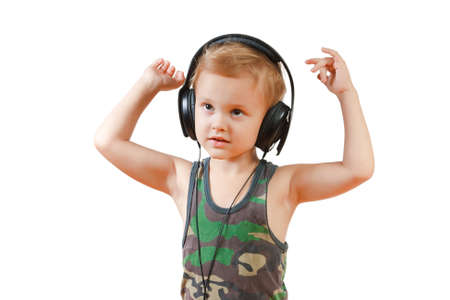 Little boy with headphones on white background photo