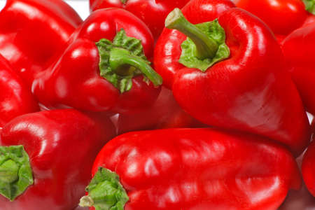 Red fresh tasty bell peppers closeup