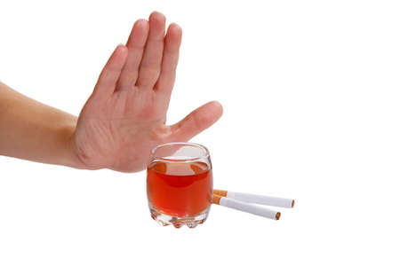 hand stop: The hand rejects cigarette and alcohol. Stop smoking and drinking. Stock Photo