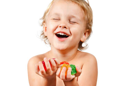 Little boy with colored jelly candies on white background Reklamní fotografie