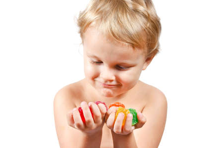 Little boy with colored jelly candies on white background Stock Photo - 10898727