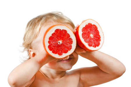 freshest: Little boy with a pink grapefruit on a white background