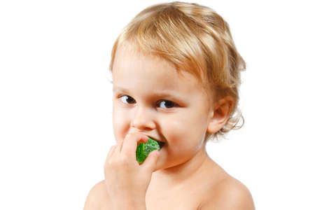 Little boy with green jelly candy on white background Stock Photo - 10898730