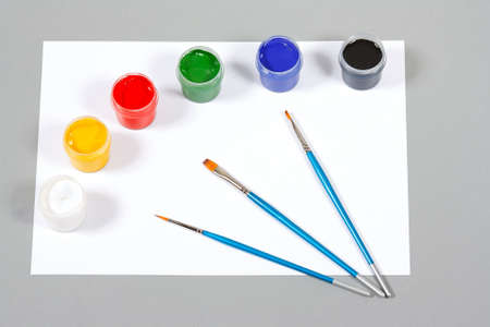Set of art gouache paints and brushes to paint and paper photo