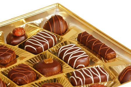 Sweets from a black and white chocolate in a box photo