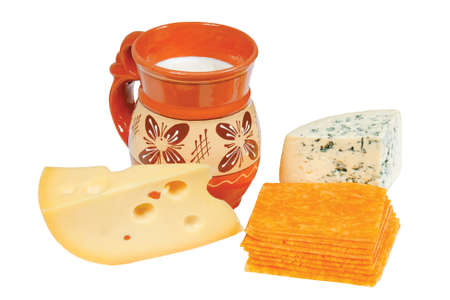 Pitcher of milk and cheese on white background