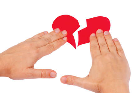 work heart: Hands combine broken red heart on a white background