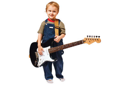 Little boy with electric guitar on white background photo