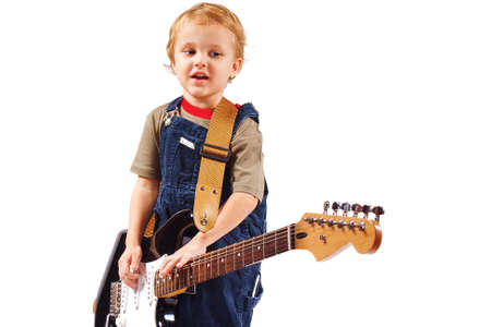Little boy with electric guitar on white background Stock Photo - 11235240