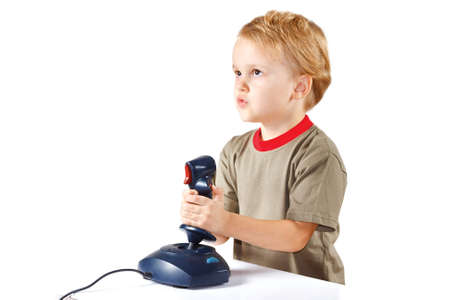 Little boy plays with a joystick on a white background Stock Photo - 11392358