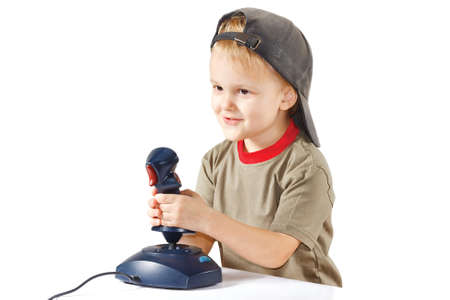 Little boy plays with a joystick on a white background photo