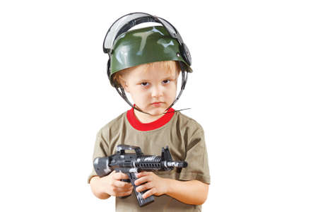 Little boy plays with gun on a white background Stock Photo - 11392392