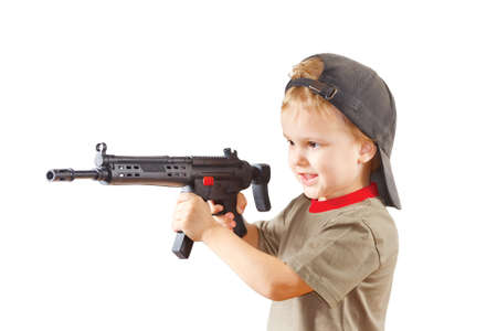 Little boy plays with gun on a white background Stock Photo - 11392359