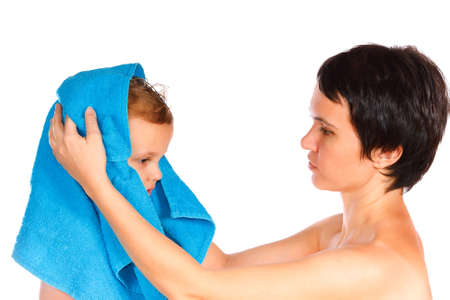 Mother wipes head to his son after bathing photo