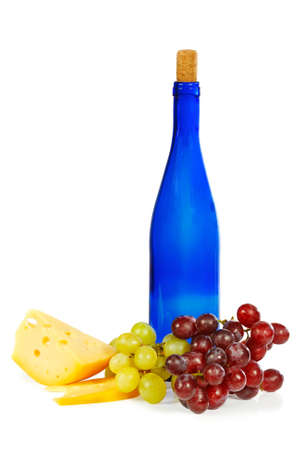 Blue bottle, grapes and cheese on white background photo