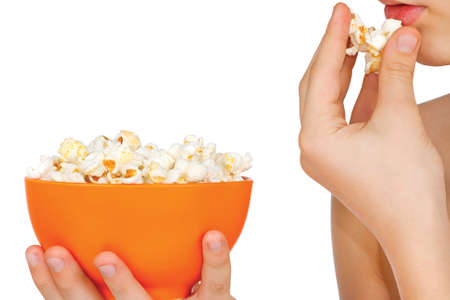 Teenager eating popcorn on a white background
