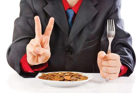 Businessman eating money on a white background photo