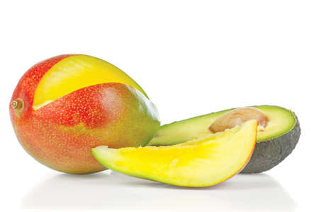 Sliced fresh avocado and mango on a white background