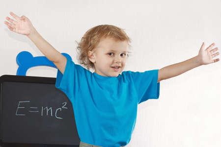 Little boy shows Einstein photo