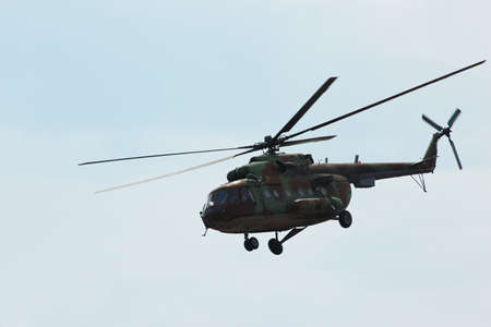 heli: Russian military helicopter MI-8 make maneuvers in the cloudy sky