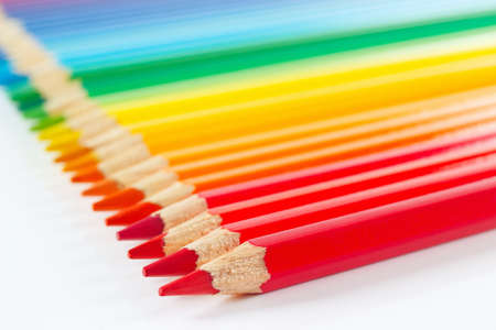 Set of multicolored pencils on a white background closeup photo
