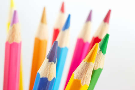 Color pencils for creativity on a white background closeup photo