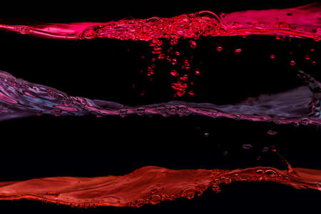 Set of water waves red and purple colors on a black background photo