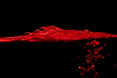 Red water wave and splash on a black background photo