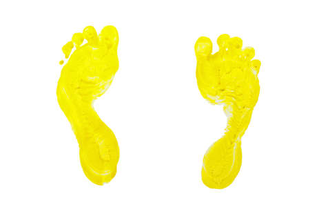 children s feet: Yellow prints of children s feet isolated on a white background Stock Photo