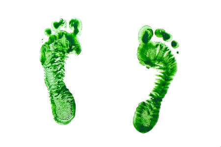 children s feet: Green prints of children s feet isolated on a white background Stock Photo