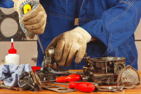 Repair of parts car engine in the workshop