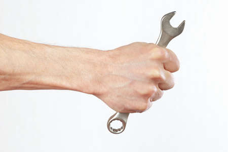 Hand of serviceman with a spanner closeup photo