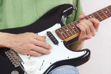 Posing hands of the rock musician playing the electric guitar photo